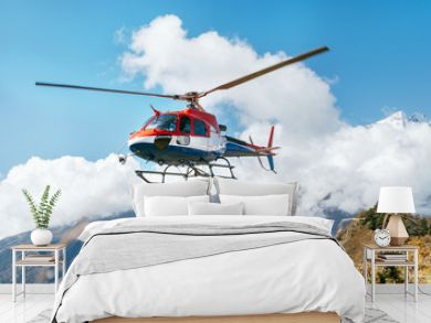 Medical Rescue helicopter landing in high altitude Himalayas mountains. Safety and travel insurance concept image.