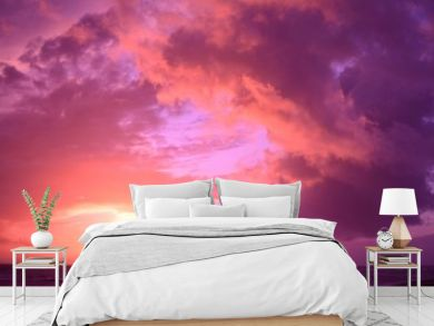 Breathtaking cloudy sunset sky scenery with vibrant pink colors - perfect for a wallpaper