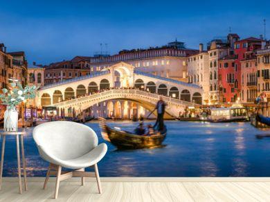 Romantic gondola ride near Rialto Bridge in Venice, Italy