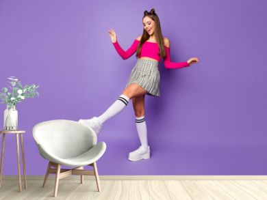 Full size photo of funny crazy lady raise leg dancing star wear pink off-shoulders cropped top plaid skirt long knee socks shoes isolated pastel purple color background