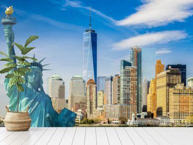 new york cityscape, tourism concept photograph statue of liberty, lower manhattan skyline