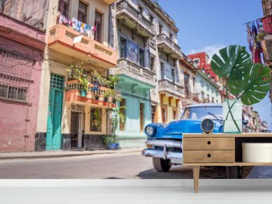 Blue vintage classic american car in a colorful street of Havana, Cuba. Travel and tourism concept.