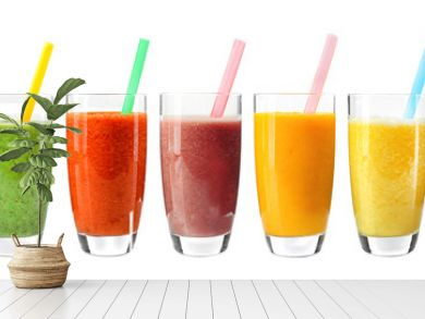 Collage of glasses with fresh delicious smoothie and straw on white background