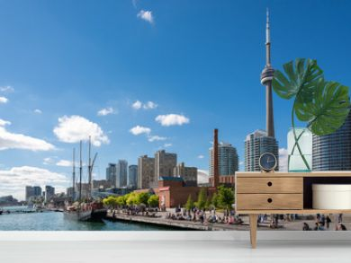 People enjoying beautiful sunny afternoon near lake Ontario in Toronto
