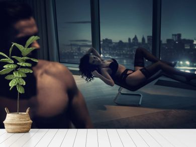 Sexy couple relaxing on the top of a skyscraper