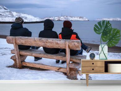 People on the bench in Teriberka, Murmansk Region, Russia