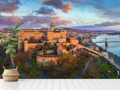 Budapest, Hungary - Golden sunrise at Buda Castle Royal Palace with Szechenyi Chain Bridge, Parliament and colorful clouds