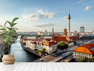 Berlin skyline panorama with TV tower and Spree river at sunset, Germany