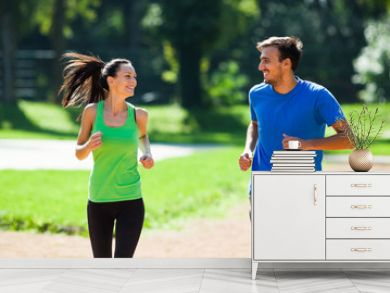 Happy couple jogging outdoor