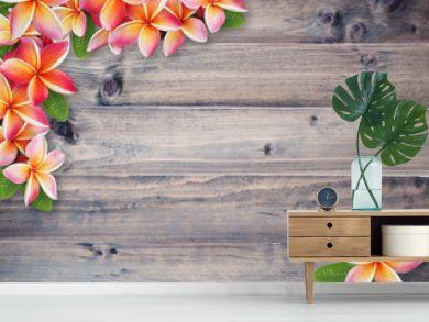 plumeria flower on brown wood background