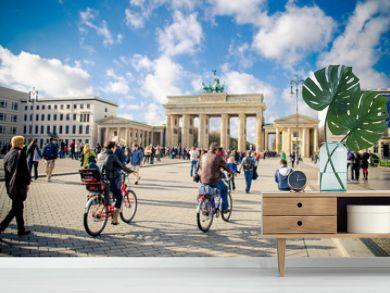 People cycling near Brandenburg Gate, Berlin, Germany