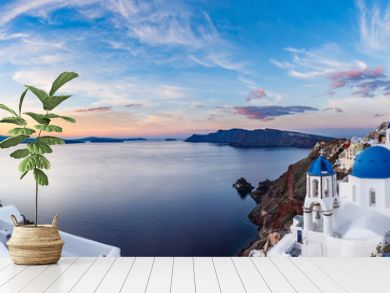 Beautiful panorama view of Santorini island in Greece at sunrise with dramatic sky.
