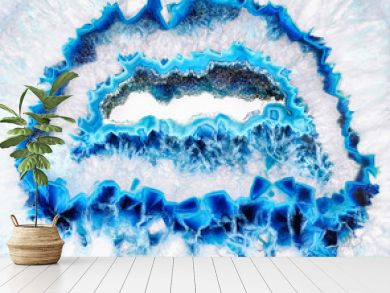 Amazing Blue Agate Crystal cross section isolated on white background. Natural translucent agate crystal surface, Blue abstract structure slice mineral stone macro closeup
