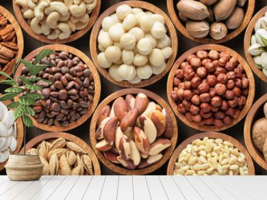assorted nuts background, vegetarian food in wooden bowls, top view